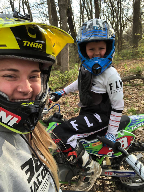 Nicole and her son riding dirt bikes